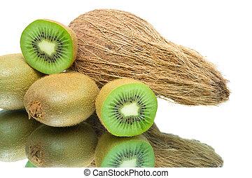 ripe kiwi fruit and coconut closeup on white background