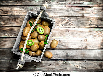 Ripe kiwi in a wooden box.