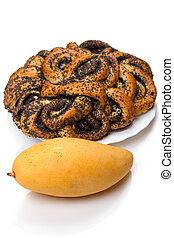 Ripe mango and bun with poppy