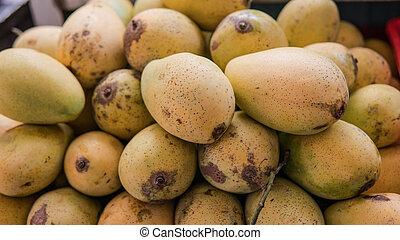 ripe mango on the counter close-up. Thailand fruits market