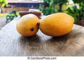 Ripe mango onwood