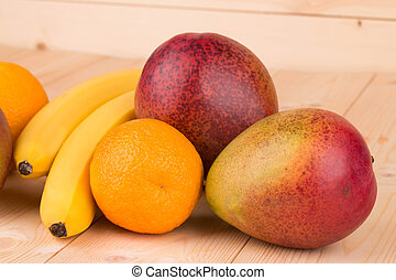 Ripe mangoes and citrus fruits.
