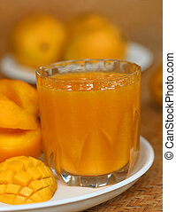 Ripe mangoes with juice
