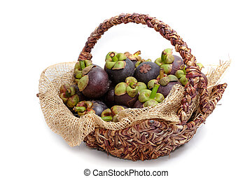 ripe mangosteen fruits in basket isolated on white background