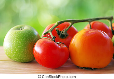 Ripe natural tomatoes, apple and diospyros
