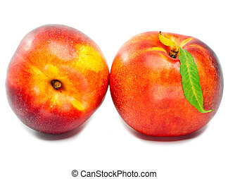 Ripe nectarine with a green leaf on a white background