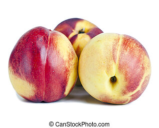 Ripe nectarines on a white background