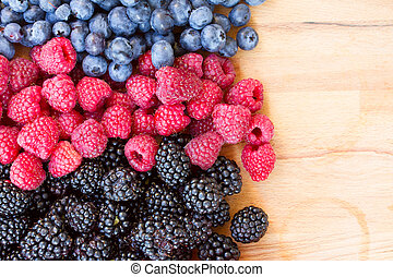 ripe  of fresh berries on table