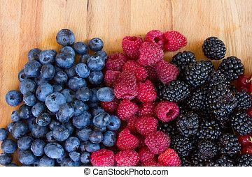 ripe of fresh berries on table - ripe of fresh raspberry, ...