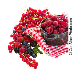 Ripe of fresh raspberry with mix of berries isolated on white background