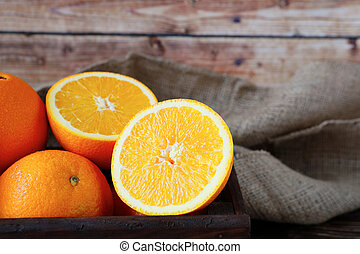 ripe orange in a wooden crate
