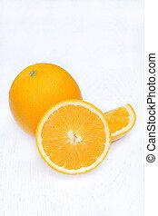 Ripe orange isolated on white wooden background