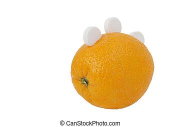 Ripe orange with three white round of vitamin C isolated on white background