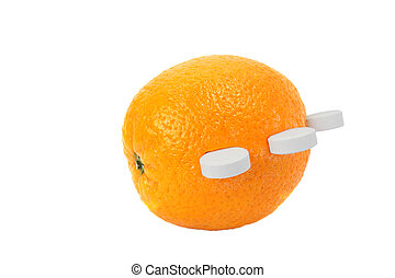 Ripe orange with white round tablets of vitamin C isolated on white background