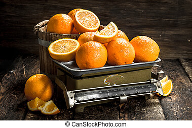 Ripe oranges on the scales.