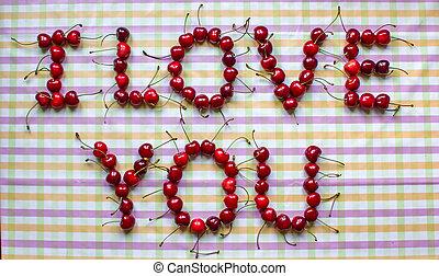 Ripe organic homegrown cherries , I love you text