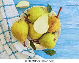 ripe organic pear on a blue wooden background autumn harvest