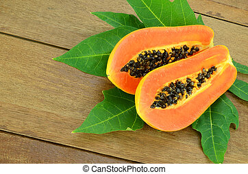 Ripe papaya on wood background. - Ripe papaya, Pawpaw or...