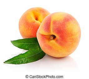 ripe peach fruits with green leaves isolated on white background