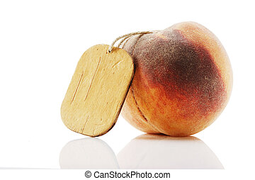 ripe peach with tag isolated on white background