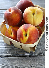 ripe peaches in a wooden crate