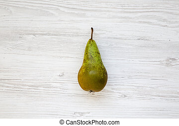 Ripe pear on white wooden background, top view. From above.