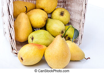Ripe pears in a basket isolated on white background