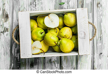 Ripe pears in the box.