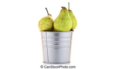 Ripe pears on metal buket isolated on white background,