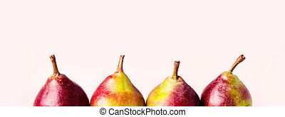 Ripe pears on pink background. Autumn harvest concept.