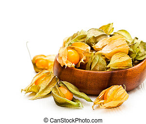 ripe physalis in wooden bowl on white background