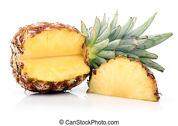 Ripe pineapple fruit with slices isolated