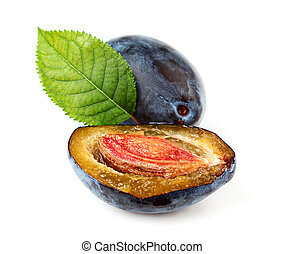 Ripe plum with leaves