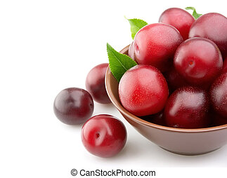 Ripe plums in a plate
