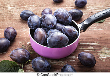 ripe plums in a saucepan