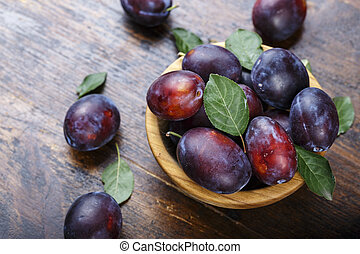 ripe plums on the table
