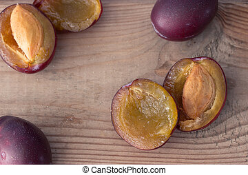 ripe plums on the wooden table
