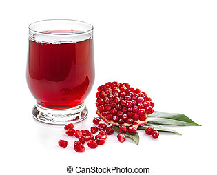 Ripe pomegranate and glass of juice on a white background