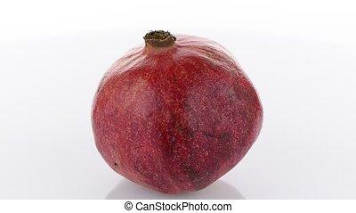 Ripe pomegranate fruit isolated on white background.