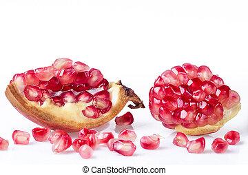 Ripe pomegranate fruit isolated on white - Broken...