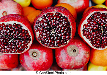Ripe pomegranate fruits on the market counter
