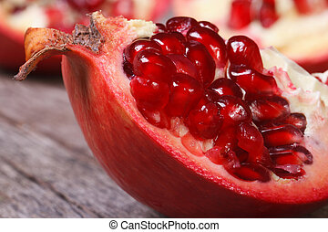 ripe pomegranate on an old wooden