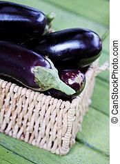 purple eggplant in a wicker basket