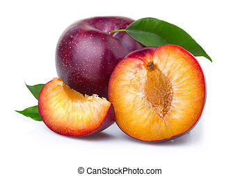 Ripe purple plum fruits with green leaves isolated