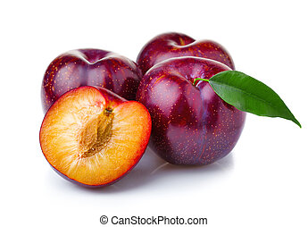 Ripe purple plum fruits with green leaves isolated on white