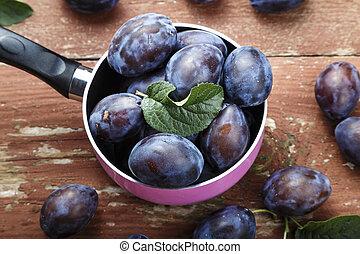 ripe purple plums