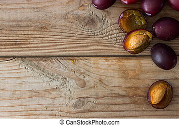 ripe purple plums on the table