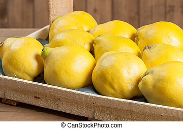 Ripe Quince Fruits In Wooden Box. - Ripe Quince Fruits In ...
