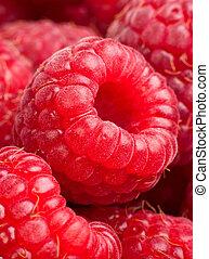Background of ripe red raspberries. Close up macro shot