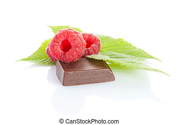 ripe raspberry on chocolate bar